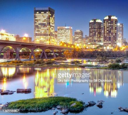 City lights reflect on James river