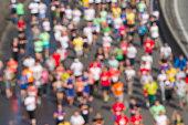 City marathon of blurred people runners