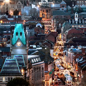 Elevated city view at night with Christmas market stalls in the high street