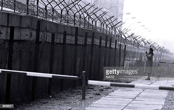 City of Berlin West Berliner at the foot of the wall talks to East Berliner November 1962 NATO celebrates its fiftieth anniversary on Washington DC...