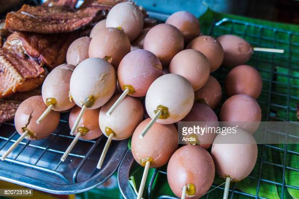 egg kebabs on a market stall