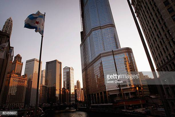 A city of Chicago flag flies in front of the Trump International Hotel Tower in the city's business district August 18 2008 in Chicago Illinois The...