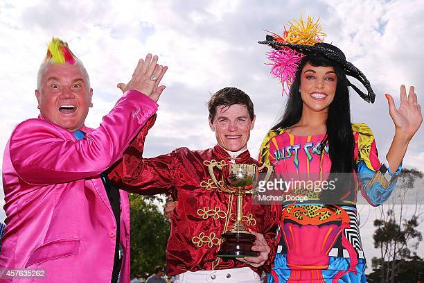 City of Greater Geelong Mayor Cr Darryn Lyons and his fiancee Elissa Friday pose with Craig Williams after he won on Caravan Rolls On in race 7 the...