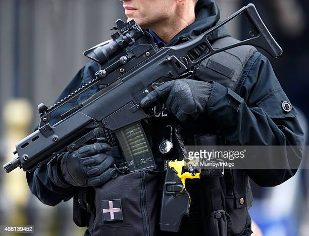 A City of London armed Police officer carrying a Heckler and Koch G36 556 Caliber Assault Rifle Taser and handgun on guard during a Service of...
