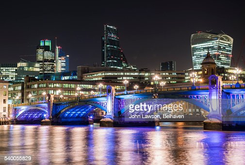 City of London at night over Southwark Bridge