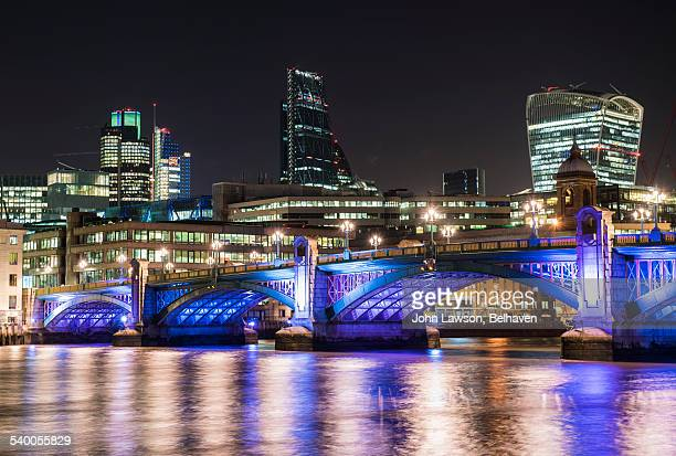 City of London at night over Southwark Bridge