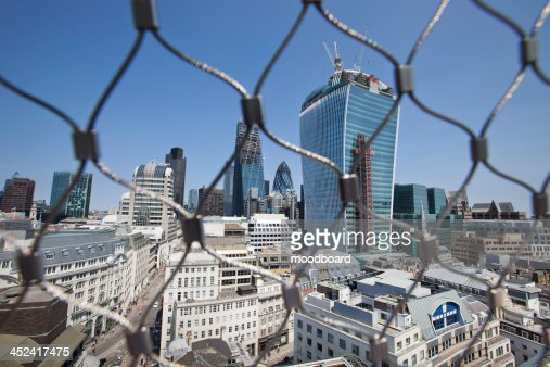 City of London Behind wire net at the top of the Monument, London : Stock Photo