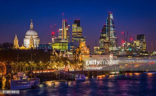 City of London glittering skyscrapers and St Pauls illuminated night