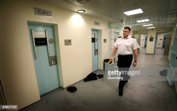 City of London police officer is seen in the detention cells area at Bishopsgate police station in the heart of London's financial district Thursday...