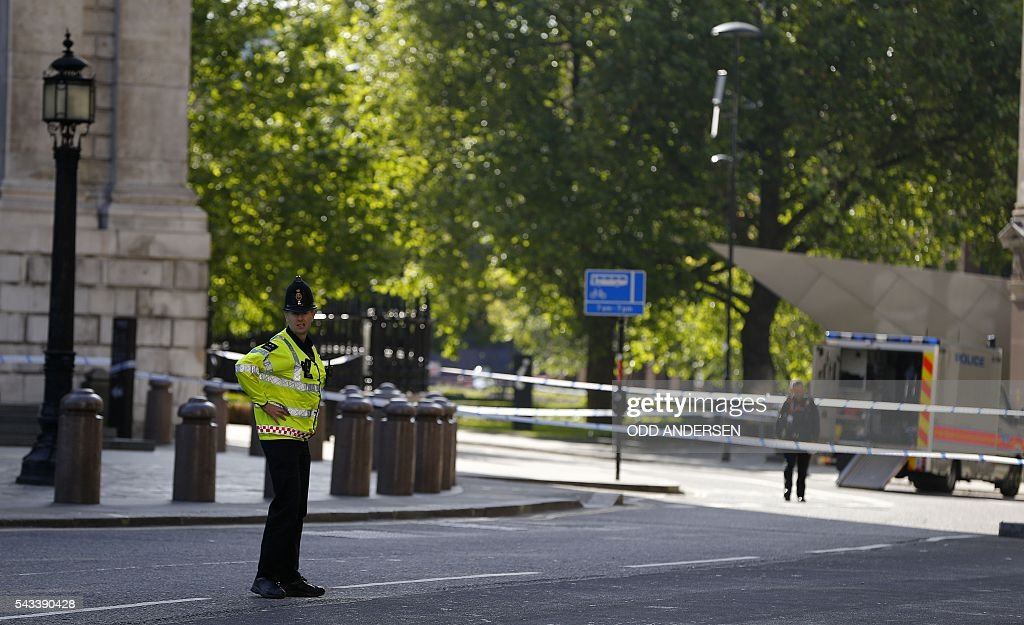 City of London police officers stand guard after cordoning off the streets around St. Paul's Cathedral in central London on June 28, 2016, as they investigated a suspect package. / AFP / ODD