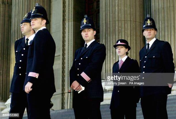 City of London police officers step up security outside St Paul's Cathedral in the City of London where a memorial service is due to take place to...