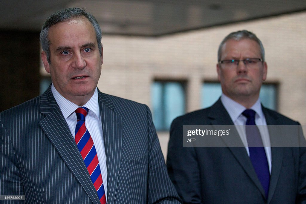 City of London Police Police Commander Steve Head (L) and the Crown Prosecution Service's Andrew Penhale (R) make a statement to the media after former UBS banker Kweku Adoboli was found guilty of two counts of fraud and sentenced to seven years in prison at Southwark Crown Court in London on November 20, 2012. UBS trader Kweku Adoboli was jailed for seven years in London for gambling away 2.3 billion USD of the Swiss bank's money in Britain's biggest ever fraud.
