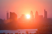 View of City of London's high rise architecture at sunset.