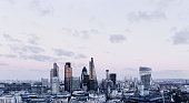 City Of London skyline at sunset, with cloudy sky