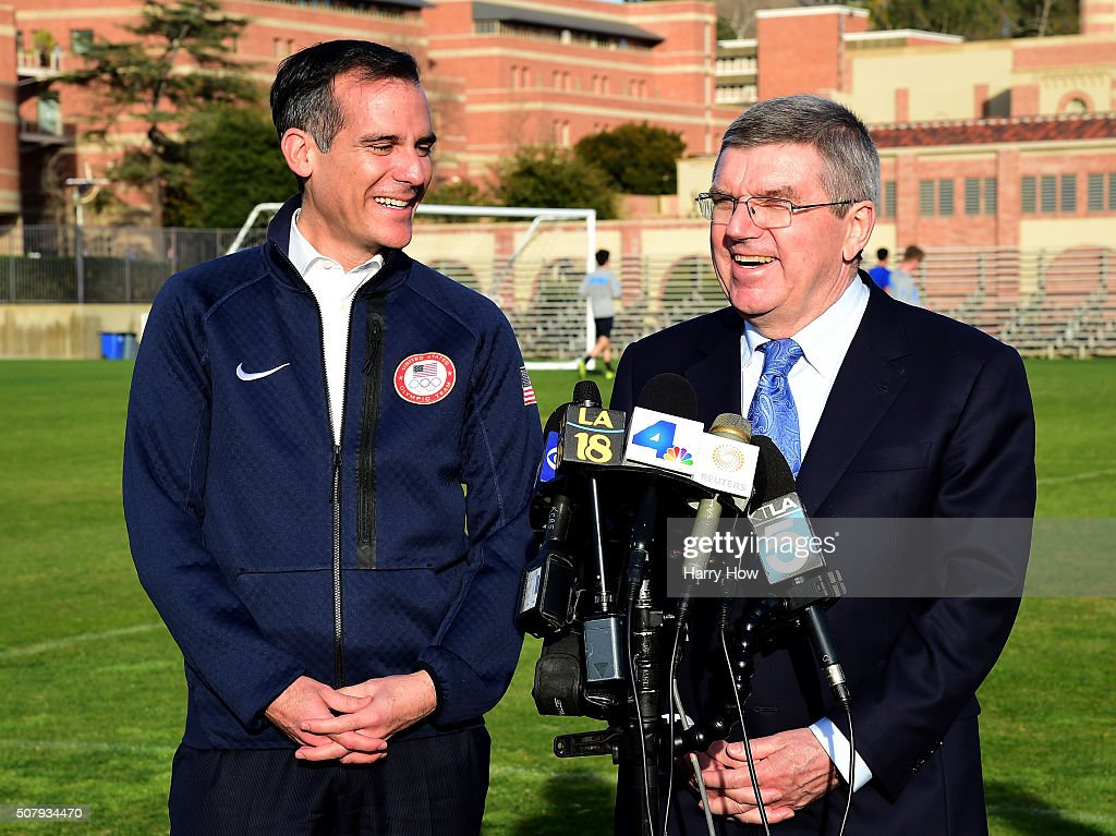 City of Los Angeles Mayor Eric Garcetti and IOC President Thomas Bach laugh at a press conference as Bach tours Los Angeles and the UCLA campus for...