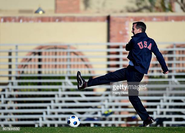 City of Los Angeles Mayor Eric Garcetti attempts a shot on the soccer field before a press conference as IOC President Thomas Bach tours Los Angeles...