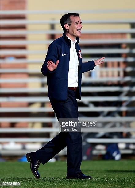 City of Los Angeles Mayor Eric Garcetti laughs on the soccer field before a press conference as IOC President Thomas Bach tours Los Angeles and the...
