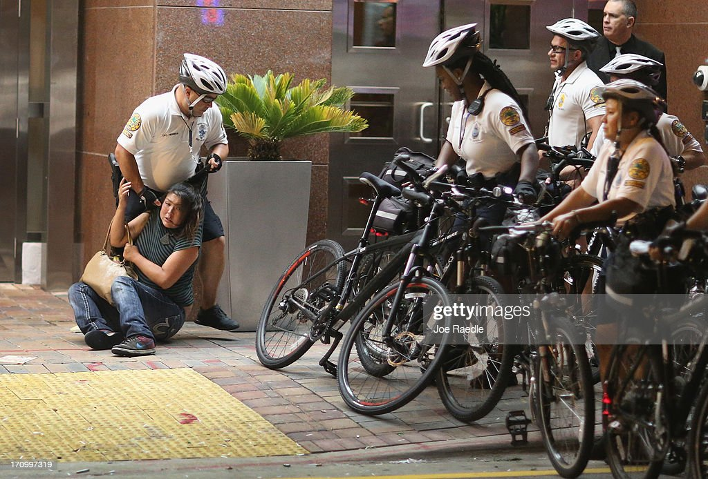 City of Miami Police apprehend a women as they try to clear a street of Miami Heat revellers after the Heat won the NBA title against the San Antonio Spurs June 20, 2013 in Miami, Florida. The Heat won back to back championships.