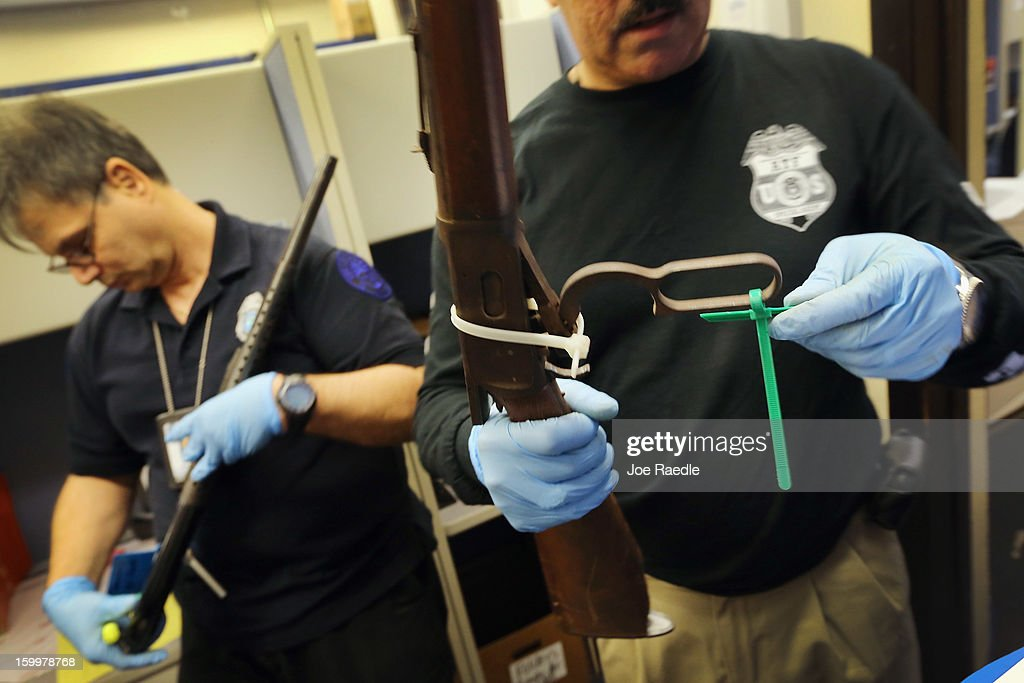 City of Miami Police officer Manuel Perez (L) and City of Miami Police Homicide/Gun Squad Detective Enrique Chavez process weapons at the City of Miami police station after the guns were turned in during a recent gun buyback program on January 24, 2013 in Miami, Florida. As the Federal Government begins to grapple with the gun issue after recent mass shootings, Miami took in 130 guns during a recent gun buyback.