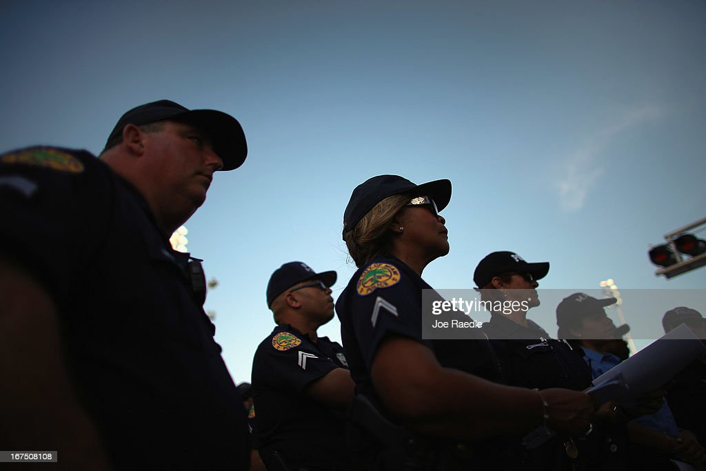 City of Miami police officers are given last minute instructions during roll call before heading out as stepped up security measures were put into place for the Mercedes-Benz Corporate Run after the bombing at the Boston Marathon on April 25, 2013 in Miami, Florida. More than 20,000 people participated in the run.