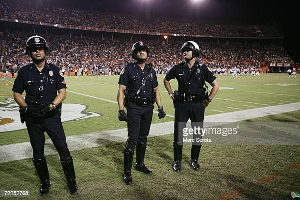 City of Miami Police Officers stand on the sideline during the Miami Hurricanes game against the Florida International Panthers at the Orange Bowl on...