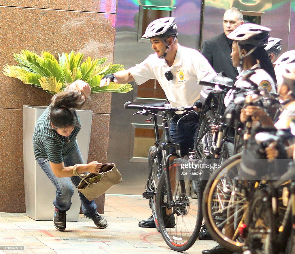 City of Miami Police push a woman to the ground as they try to clear a street of Miami Heat revellers after the Heat won the NBA title against the San Antonio Spurs on June 20, 2013 in Miami, Florida. The Heat have won back to back championships.