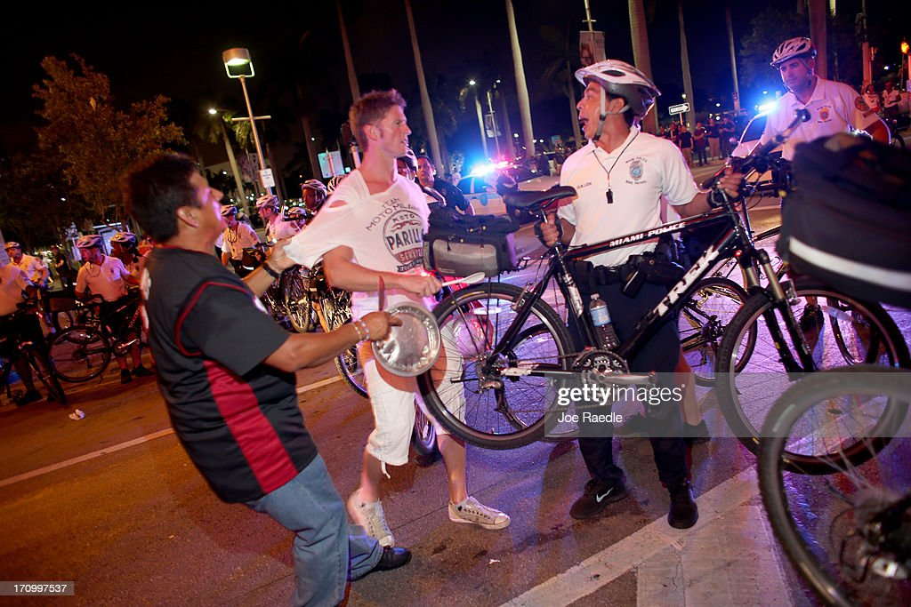 City of Miami Police try to clear a street of Miami Heat revellers after the Heat won the NBA title against the San Antonio Spurs June 20, 2013 in Miami, Florida. The Heat have won back to back championships.