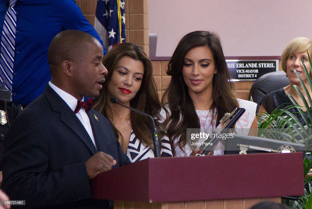 City of North Niami Mayor Andre D. Pierre, <a gi-track='captionPersonalityLinkClicked' href=/galleries/search?phrase=Kourtney+Kardashian&family=editorial&specificpeople=3955024 ng-click='$event.stopPropagation()'>Kourtney Kardashian</a> and <a gi-track='captionPersonalityLinkClicked' href=/galleries/search?phrase=Kim+Kardashian&family=editorial&specificpeople=753387 ng-click='$event.stopPropagation()'>Kim Kardashian</a> makes an appearance at North Miami City Hall to receive key to the City Of North Miami on November 19, 2012 in North Miami, Florida.