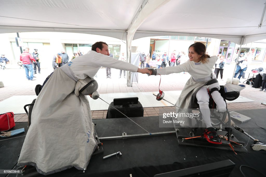 City of Ottawa Councillor Mathieu Fleury and Paralympian Camille Chai shake hands after demonstrating wheelchair fencing during an outdoor demonstration on Sparks Street during the Medley on the Street event on April 20, 2017 in Ottawa, Canada. The Medley on the Street event promotes Fencing Week in Canada and the upcoming National Canadian Fencing Championships.