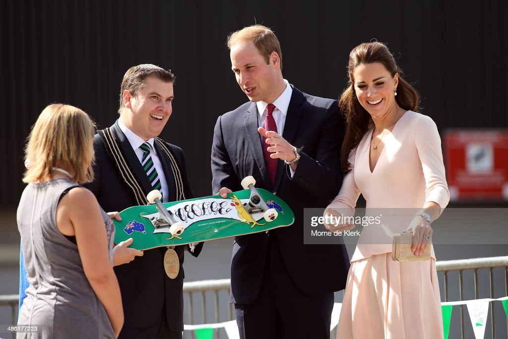 City of Playford Mayor, Mr Glenn Docherty, presents a skateboard to Prince William, Duke of Cambridge and <a gi-track='captionPersonalityLinkClicked' href=/galleries/search?phrase=Catherine+-+Duchess+of+Cambridge&family=editorial&specificpeople=542588 ng-click='$event.stopPropagation()'>Catherine</a>, Duchess of Cambridge at a skate park in Elizabeth, on April 23, 2014 in Adelaide, Australia. The Duke and Duchess of Cambridge are on a three-week tour of Australia and New Zealand, the first official trip overseas with their son, Prince George of Cambridge.