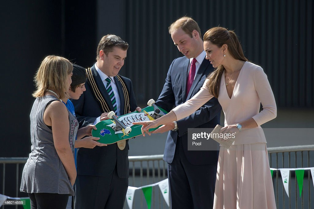 City of Playford Mayor, Mr Glenn Docherty presents a skateboard with the words 'George' painted on to <a gi-track='captionPersonalityLinkClicked' href=/galleries/search?phrase=Prince+William&family=editorial&specificpeople=178205 ng-click='$event.stopPropagation()'>Prince William</a>, Duke of Cambridge and <a gi-track='captionPersonalityLinkClicked' href=/galleries/search?phrase=Catherine+-+Duchess+of+Cambridge&family=editorial&specificpeople=542588 ng-click='$event.stopPropagation()'>Catherine</a>, Duchess of Cambridge at a skate park in Elizabeth, on April 23, 2014 in Adelaide, Australia. The Duke and Duchess of Cambridge are on a three-week tour of Australia and New Zealand, the first official trip overseas with their son, Prince George of Cambridge.