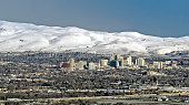 A high angle view of Downtown Reno Nevada as seen from the south east showing casinos and snow capped mountains.