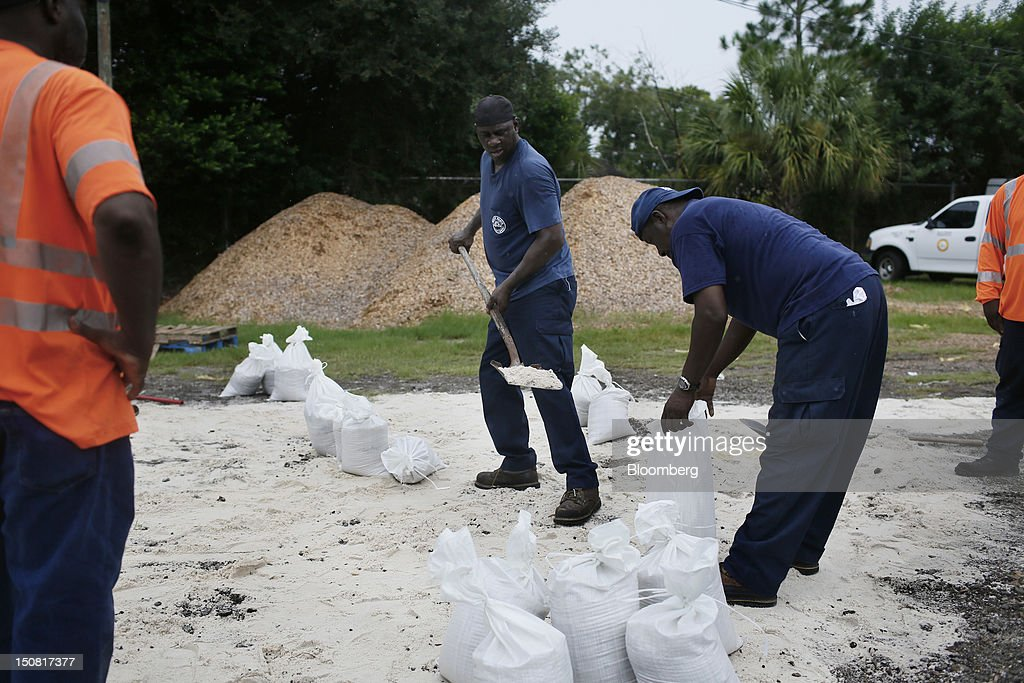 City of Tampa workers fill sand bags in anticipation of Hurricane Isaac in Tampa, Florida, U.S., on Sunday, Aug. 26, 2012. Tropical Storm Isaac regained strength as it entered the Gulf of Mexico, forcing oil and gas production sites in its path to close and threatening the coasts of four U.S. states with a possible Category-2 hurricane. Photographer: Victor J. Blue/Bloomberg via Getty Images