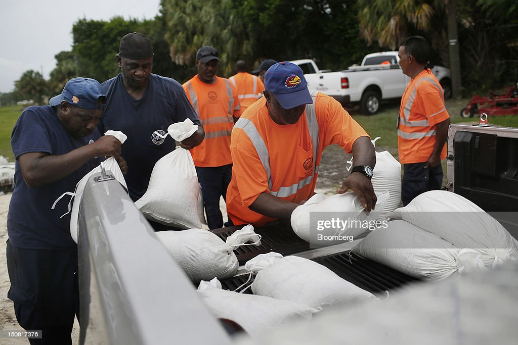 City of Tampa workers put sand bags in the back of a truck in Tampa, Florida, U.S., on Sunday, Aug. 26, 2012. Tropical Storm Isaac regained strength as it entered the Gulf of Mexico, forcing oil and gas production sites in its path to close and threatening the coasts of four U.S. states with a possible Category-2 hurricane. Photographer: Victor J. Blue/Bloomberg via Getty Images