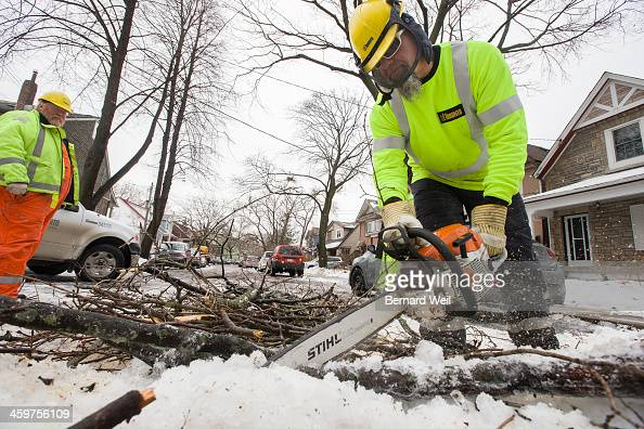 TORONTO ON DECEMBER 29 City of Toronto worker Bill D and coworkers clear downed tree limbs on West Lynn Ave in the Coxwell and Danforth area The...