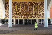 A city official walks near the Trump Taj Mahal casino hotel on the boardwalk in Atlantic City New Jersey on May 8 2016 Atlantic City the famous US...