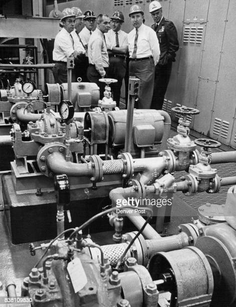 City officials inspect pumps part of the maze of equipment in the underground silo complex From left are City Councilmen Paul A Hentzell and Carl N...
