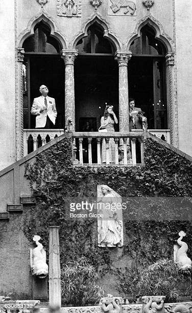 City officials look over the famous Gardner Palace courtyard at the Isabella Stewart Gardner Museum in Boston on July 6 during the National Mayor's...
