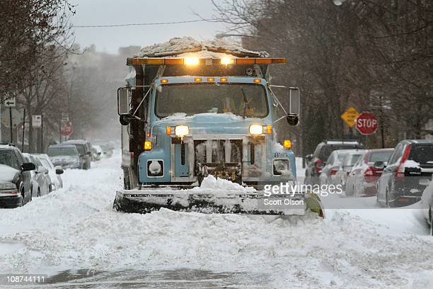 A city plow clears a residential street in the Bucktown neighborhood February 2 2011 in Chicago Illinois As of late morning over 20 inches of snow...