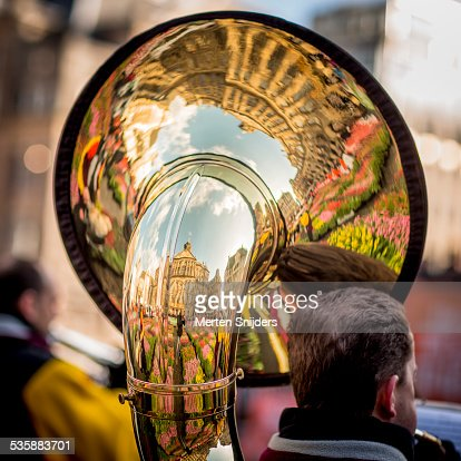 City reflections on polished brass baritone horn