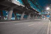 Empty City road surface floor with viaduct bridge of night scene