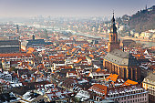 City rooftops and church in winter.