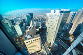 Asia Business concept for real estate and corporate construction - panoramic modern city skyline aerial view of Shinjuku area under blue sky in Tokyo, Japan