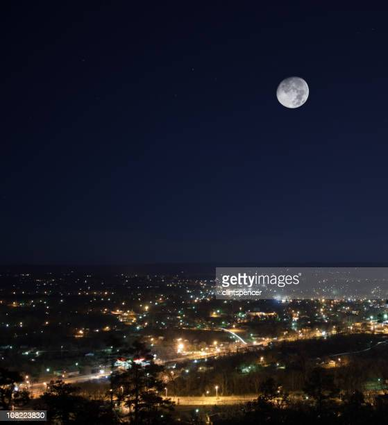 City Skyline at Night with Full Moon