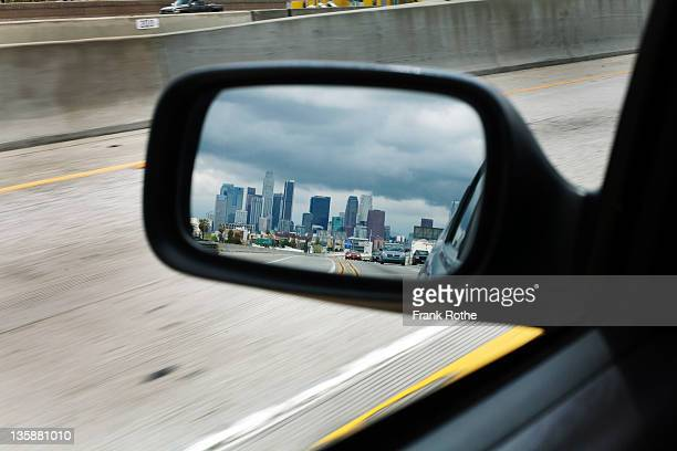 city skyline in the driving mirror