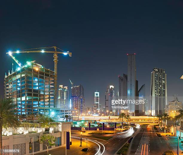 City skyscraper highway at night Dubai