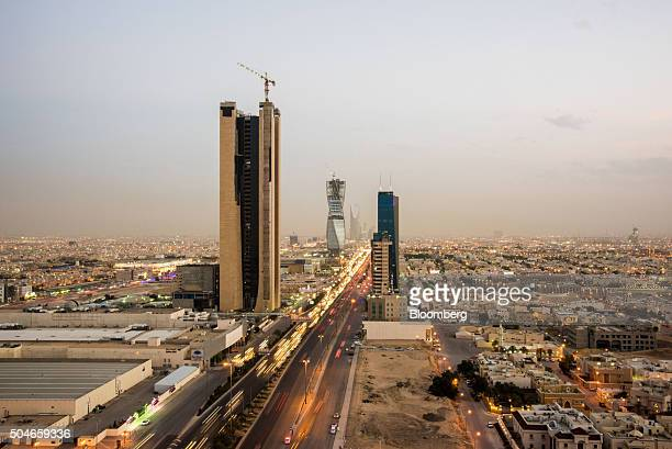 City skyscrapers stand along a main highway surrounded by residential buildings in Riyadh Saudi Arabia on Friday Jan 8 2016 Saudi Arabian stocks led...