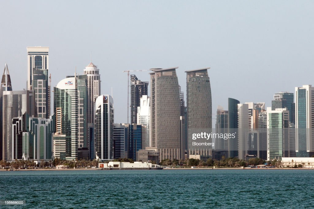 City skyscrapers stand on the skyline in Doha, Qatar, on Thursday, Nov. 22, 2012. Qatar Telecom QSC, the country's biggest company by revenue, is seeking a syndicated loan for about $1 billion to refinance existing debt, according to a person with direct knowledge of the deal. Photographer: Gabriela Maj/Bloomberg via Getty Images