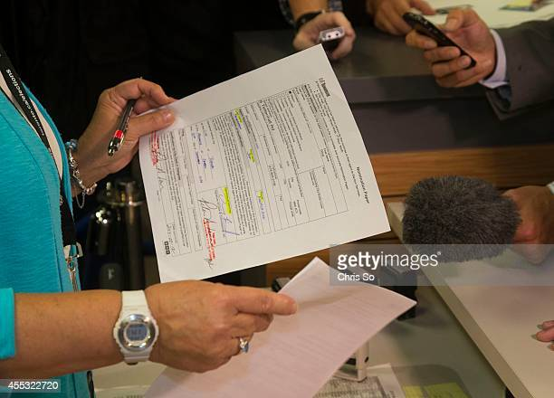 A city staffer takes Doug Ford's mayoral nomination paper from Jeff Silverstein after he returned to the elections office Minutes earlier he withdrew...