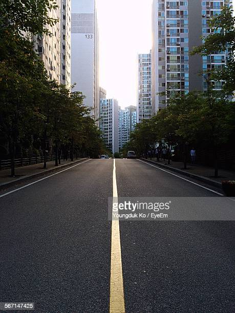 City Street With Straight Yellow Road Marking Amidst Residential District